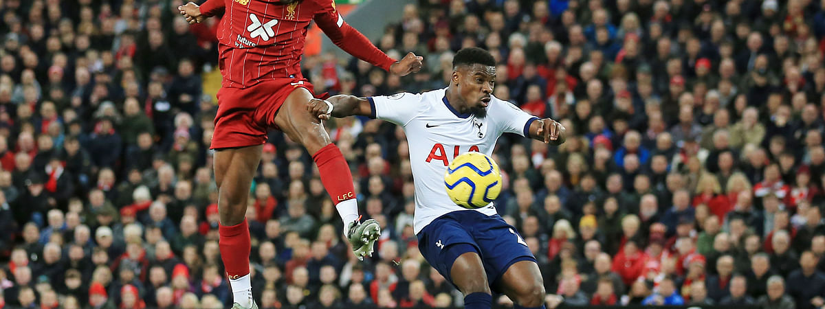 Liverpool's Georginio Wijnaldum, left, challenges for the ball with Tottenham's Serge Aurier during the English Premier League soccer match between Liverpool and Tottenham Hotspur at Anfield stadium in Liverpool, England, Sunday, Oct. 27, 2019.