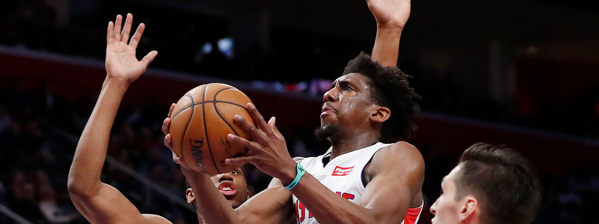 Detroit Pistons guard Langston Galloway (9) goes up for a layup as Chicago Bulls forward Thaddeus Young (21) defends during the first half of an NBA basketball game, Saturday, Dec. 21, 2019, in Detroit. (AP Photo/Carlos Osorio)