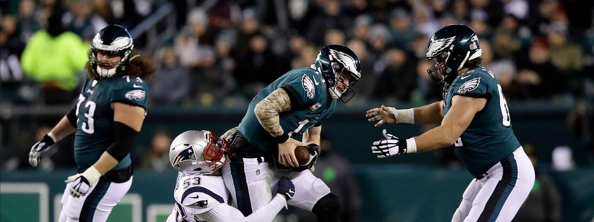 New England Patriots' Kyle Van Noy (53) tackles Philadelphia Eagles' Carson Wentz (11) during the first half of an NFL football game, Sunday, Nov. 17, 2019, in Philadelphia.