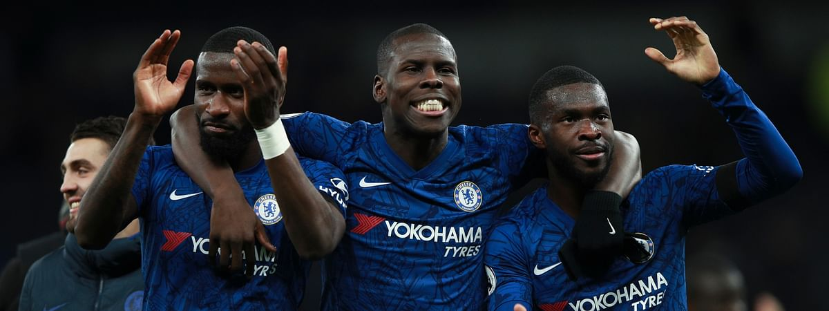 From left, Chelsea's Antonio Rudiger, Kurt Zouma and Fikayo Tomori celebrate their side's 2-0 win at the end of the English Premier League soccer match between Tottenham Hotspur and Chelsea, at the Tottenham Hotspur Stadium in London, Sunday, Dec. 22, 2019.