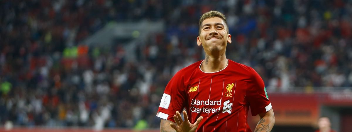 Liverpool's Roberto Firmino celebrates after a goal after the Club World Cup semifinal soccer match between Liverpool and Monterrey at the Khalifa International Stadium in Doha, Qatar, Wednesday, Dec. 18, 2019. (AP Photo/Hussein Sayed)