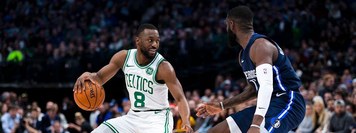 Boston Celtics guard Kemba Walker (8) controls the ball as Dallas Mavericks guard Tim Hardaway Jr. (11) defends during the first half of an NBA basketball game Wednesday, Dec. 18, 2019, in Dallas. (AP Photo/Sam Hodde)