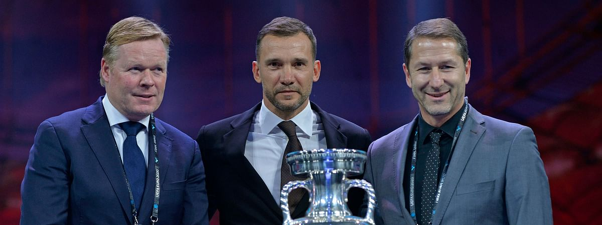 In this November 2019 file photo, Netherlands coach Ronald Koeman, Ukraine coach Andriy Shevchenko and Austria coach Franco Foda pose for a photo during the draw for the UEFA Euro 2020 soccer tournament finals in Bucharest, Romania.