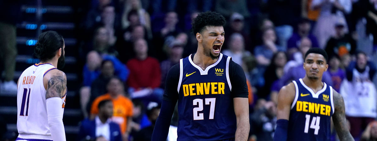 Denver Nuggets guard Jamal Murray (27) reacts after making the game winning basket against the Phoenix Suns in the second half during an NBA basketball game, Monday, Dec. 23, 2019, in Phoenix. The Nuggets defeated the Suns 113-111.