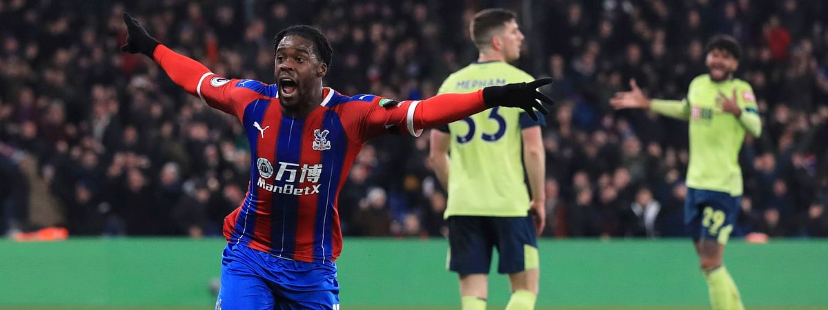 Crystal Palace's Jeffrey Schlupp celebrates scoring his side's first goal of the game against Bournemouth, during their English Premier League soccer match at Selhurst Park in London, Tuesday Dec. 3, 2019.