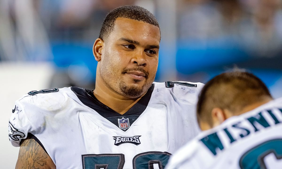 In this Oct. 12, 2017 photo, Philadelphia Eagles' Brandon Brooks (79) sits on the bench during the second half of an NFL football game against the Carolina Panthers in Charlotte, N.C.
