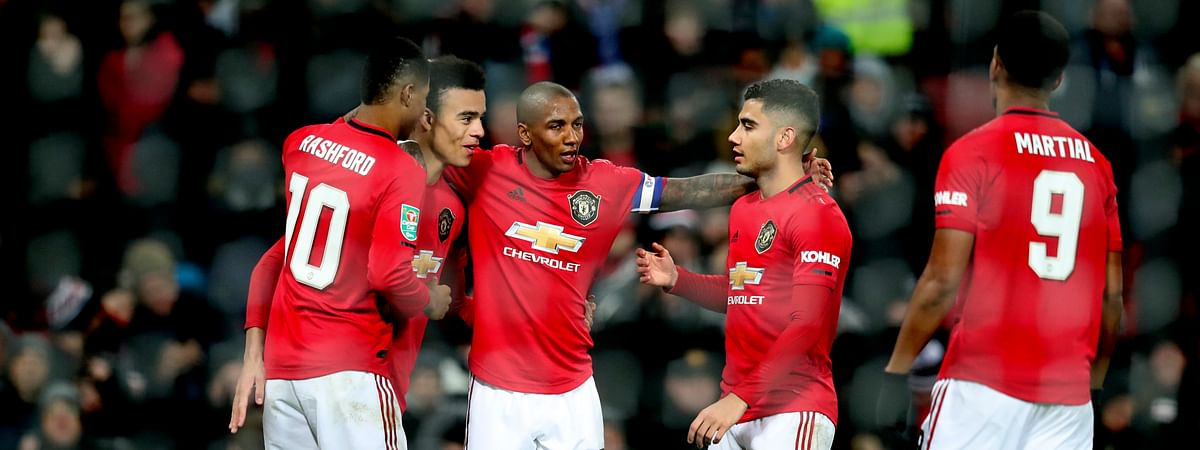 Manchester United's players celebrate after Colchester United's Ryan Jackson, scored an own goal during the English League Cup quarter final soccer match between Manchester United and Colchester United at Old Trafford in Manchester, England, Wednesday, Dec. 18, 2019.