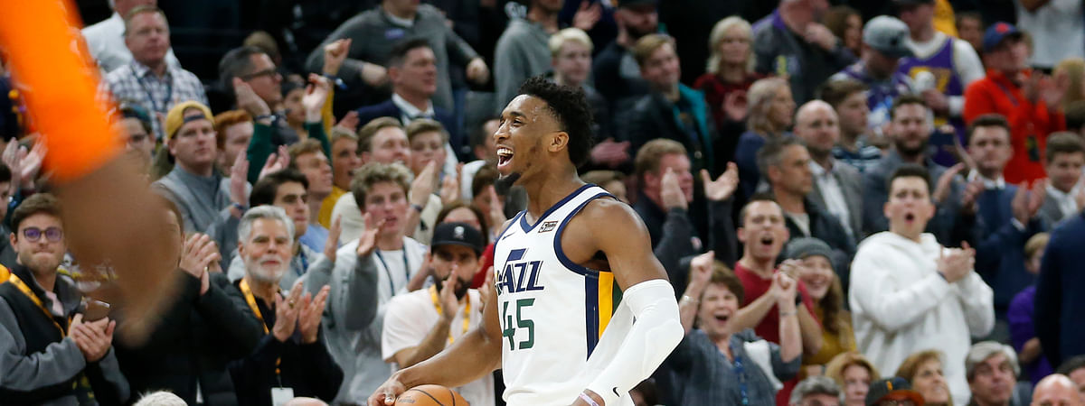 Utah Jazz guard Donovan Mitchell (45) celebrates with the fans in the second half of an NBA basketball game against the Orlando Magic Tuesday, Dec. 17, 2019, in Salt Lake City. (AP Photo/Rick Bowmer)