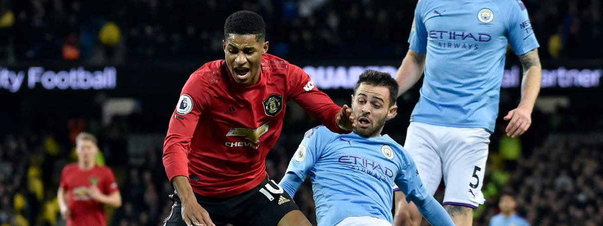 Manchester United's Marcus Rashford, left, duels for the ball with Manchester City's Bernardo Silva during the English Premier League soccer match between Manchester City and Manchester United at Etihad stadium in Manchester, England, Saturday, Dec. 7, 2019.