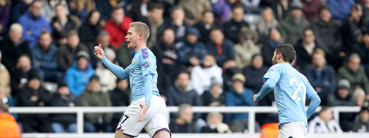 Manchester City's Kevin De Bruyne, left, celebrates scoring his side's second goal of the game during the English Premier League soccer match between Newcastle United and Manchester City at St James' Park, Newcastle, England, Saturday, Nov. 30, 2019.
