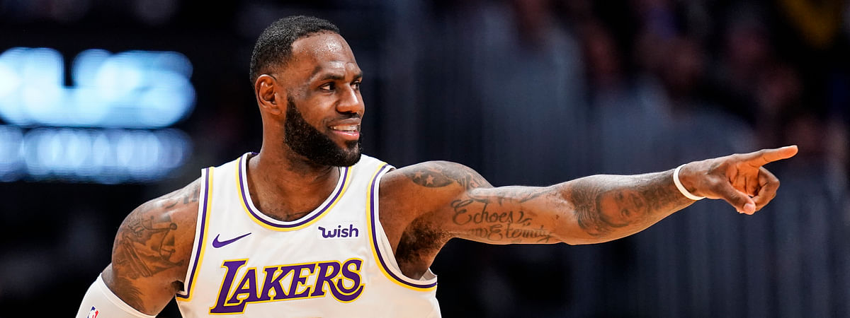 Los Angeles Lakers forward LeBron James celebrates a basket during the second half of the team's NBA basketball game against the Denver Nuggets on Tuesday, Dec. 3, 2019, in Denver. The Lakers won 105-96.