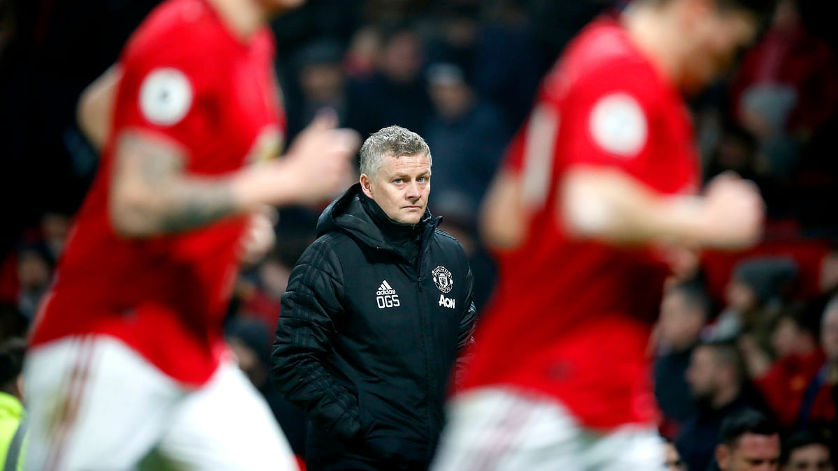 Manchester United manager Ole Gunnar Solskjaer, centre, watches the action from the touchline, during the English Premier League soccer match between Manchester United and Burnley, at Old Trafford, in Manchester, England, Wednesday, Jan. 22, 2020.