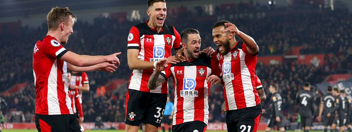 Southampton's Ryan Bertrand, right, celebrates scoring his side's second goal of the game against Norwich City, with team mates Jan Bednarek, James Ward-Prowse and Danny Ings during their English Premier League soccer match at St Mary's in Southampton, England, Wednesday Dec. 4, 2019.