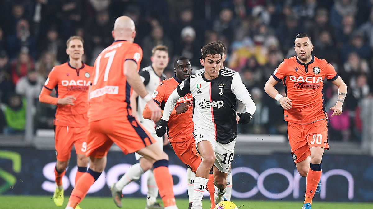 Juventus' Paulo Dybala , center right, fights for the ball with Udinese's Bram Nuytinck, center, during the Italian Cup soccer match between Juventus and Udinese, at the Allianz Stadium in Turin, Italy, Wednesday, Jan. 15, 2020.