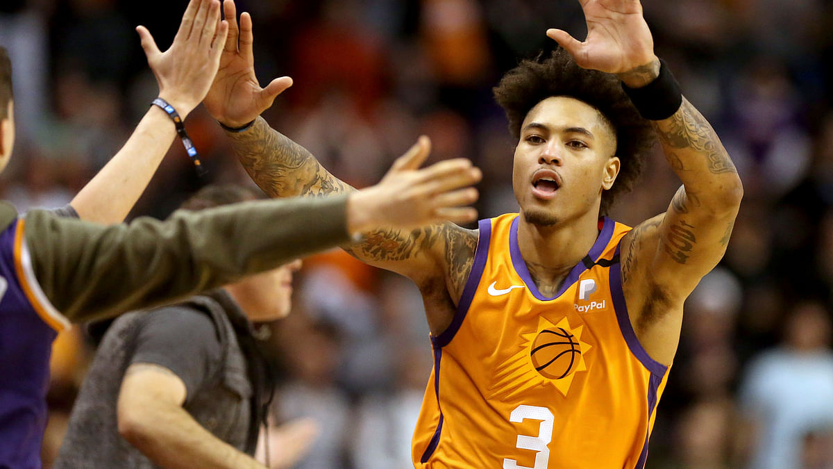 Phoenix Suns' Kelly Oubre Jr. (3) celebrate with fans after coming back late in an NBA basketball game against the Orlando Magic during the second half Friday, Jan. 10, 2020, in Phoenix.