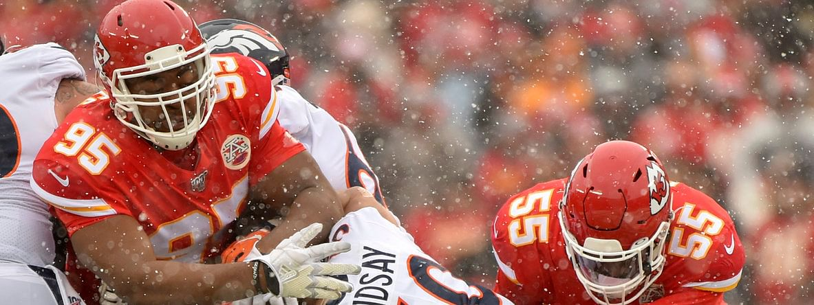 Kansas City's Chris Jones (left) and Frank Clarke tackle Denver's Phillip Lindsay on Dec. 15
