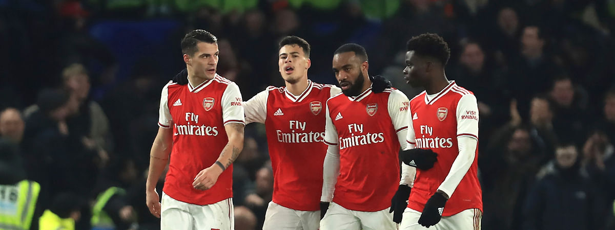 Arsenal's players celebrate a goal against Chelsea during the English Premier League soccer match between Chelsea and Arsenal at Stamford Bridge stadium in London England, Tuesday, Jan. 21, 2020.