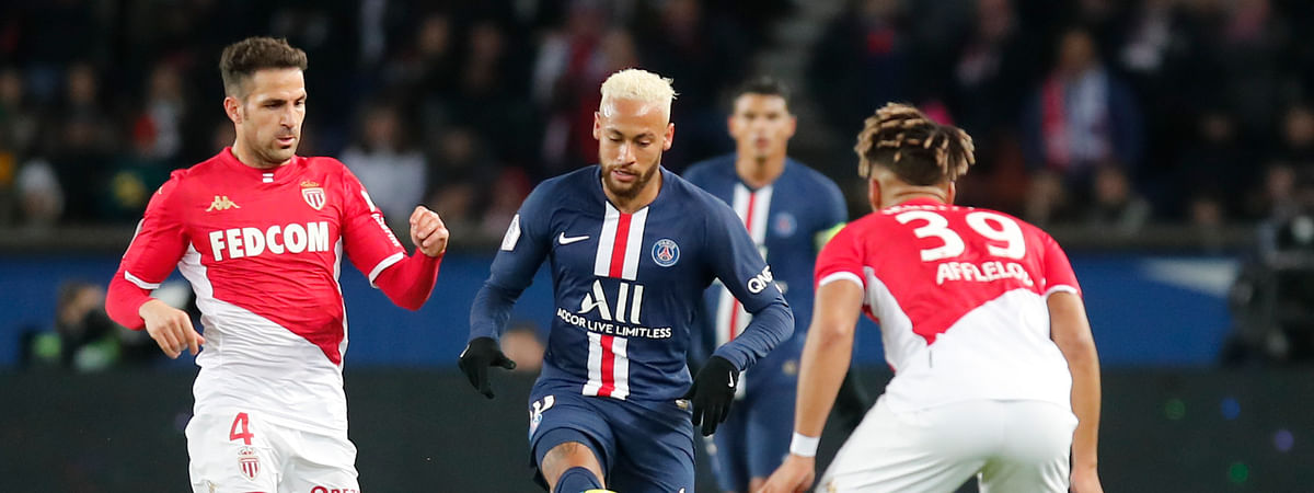 PSG's Neymar, center, is challenged by Monaco's Cesc Fabregas, left, and Benjamin Henrichs during the French League One soccer match between Paris-Saint-Germain and Monaco at the Parc des Princes stadium in Paris, Sunday Jan. 12, 2020.