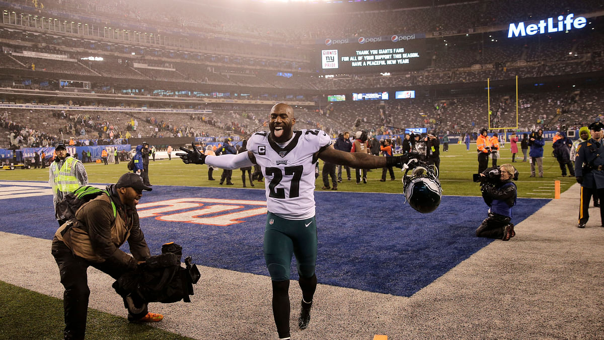 Philadelphia Eagles strong safety Malcolm Jenkins (27) celebrates beating the New York Giants after NFL football game, Sunday, Dec. 29, 2019, in East Rutherford, N.J. (AP Photo/Seth Wenig)