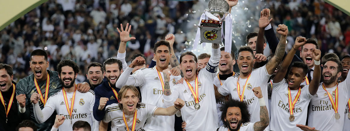 Real Madrid's Sergio Ramos holds up the trophy, at the end of the Spanish Super Cup Final soccer match between Real Madrid and Atletico Madrid at King Abdullah stadium in Jiddah, Saudi Arabia, Monday, Jan. 13, 2020. (AP Photo/Hassan Ammar)