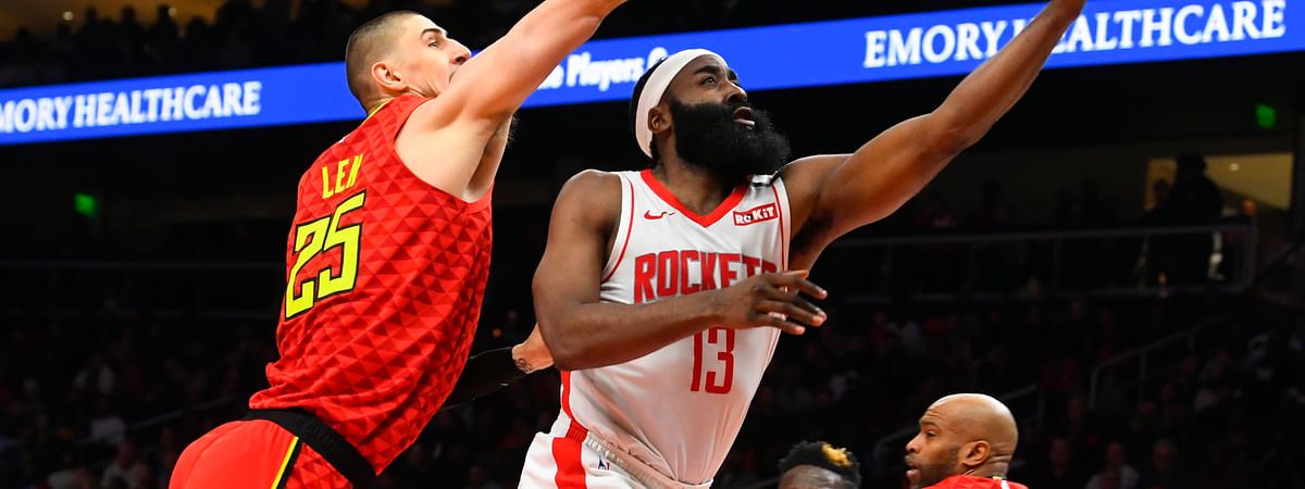 Houston Rockets guard James Harden (13) shoots as Atlanta Hawks center Alex Len defends during the second half of an NBA basketball game Wednesday, Jan. 8, 2020, in Atlanta. Houston won 122-115.