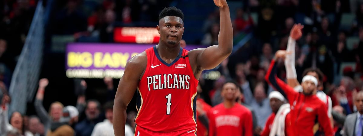 New Orleans Pelicans forward Zion Williamson (1) reacts after making a 3-point basket in the second half of an NBA basketball game against the San Antonio Spurs in New Orleans, Wednesday, Jan. 22, 2020.