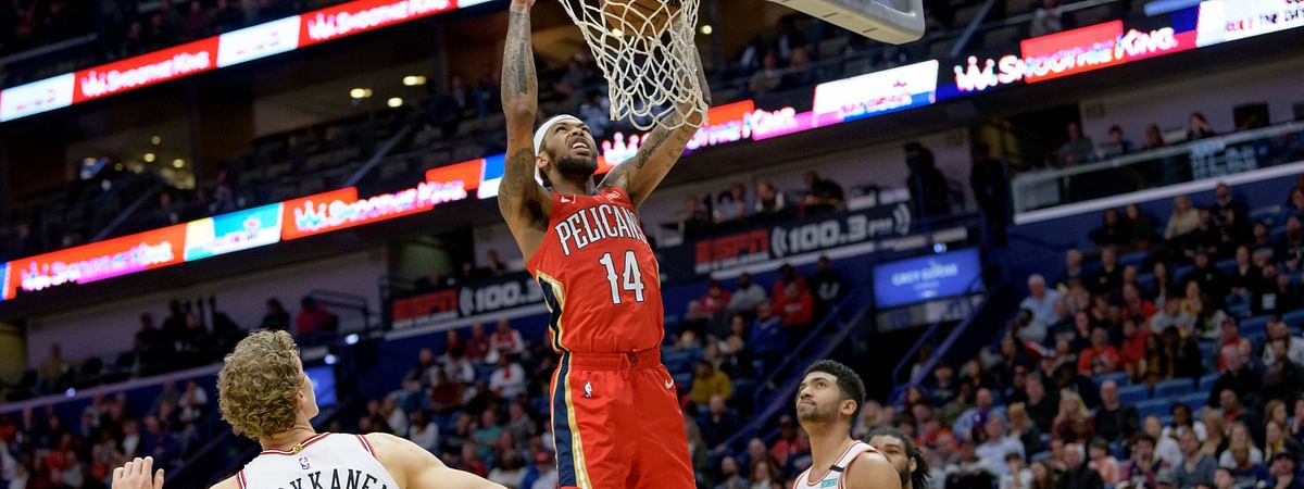 New Orleans Pelicans forward Brandon Ingram (14) goes up for a dunk against Chicago Bulls forward Chandler Hutchison (15) in the second half of an NBA basketball game in New Orleans, Wednesday, Jan. 8, 2020.