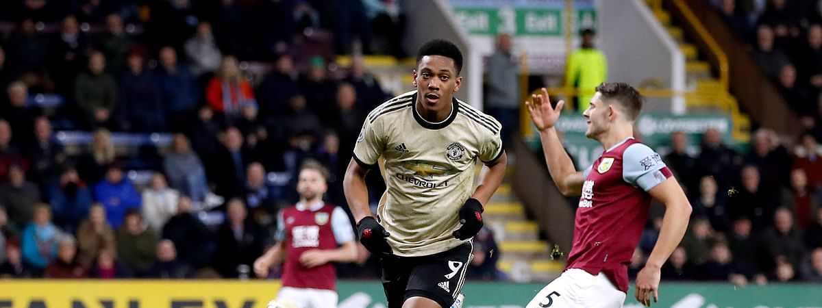 Manchester United's Anthony Martial, center, celebrates scoring against Burnley during the English Premier League soccer match at Turf Moor, Burnley, England, Saturday Dec. 28, 2019.
