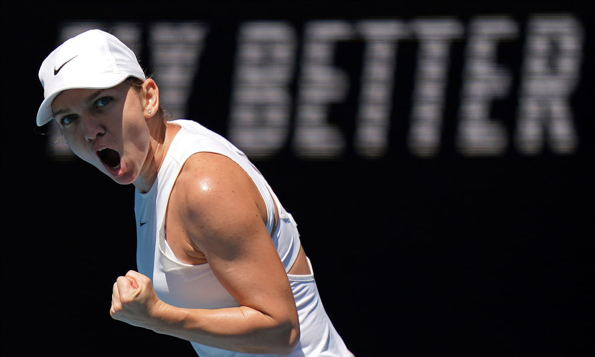 Romania's Simona Halep reacts after winning a point against Estonia's Anett Kontaveit during their quarterfinal match at the Australian Open tennis championship in Melbourne, Australia, Wednesday, Jan. 29, 2020. (AP Photo/Lee Jin-man)