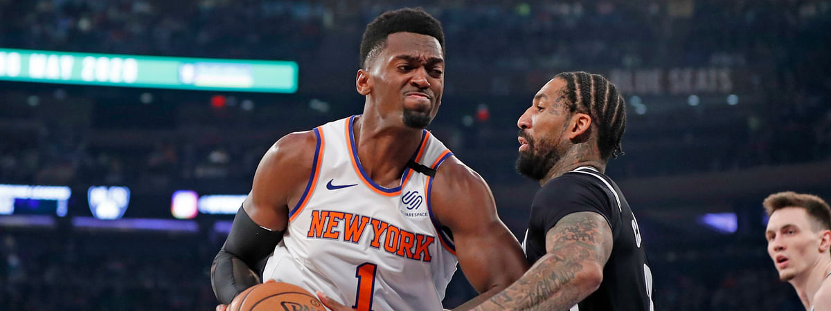 Brooklyn Nets forward Wilson Chandler (21) defends New York Knicks forward Bobby Portis (1) as Portis rives to the basket during the first half of an NBA basketball game in New York, Sunday, Jan. 26, 2020.