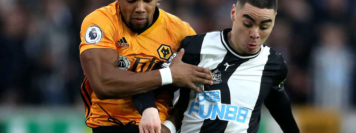Wolverhampton Wanderers' Adama Traore, left, and and Newcastle United's Miguel Almiron battle for the ball during the English Premier League soccer match between Wolverhampton Wanderers and Newcastle United at Molineux, Wolverhampton, England, Saturday Jan. 11, 2020.