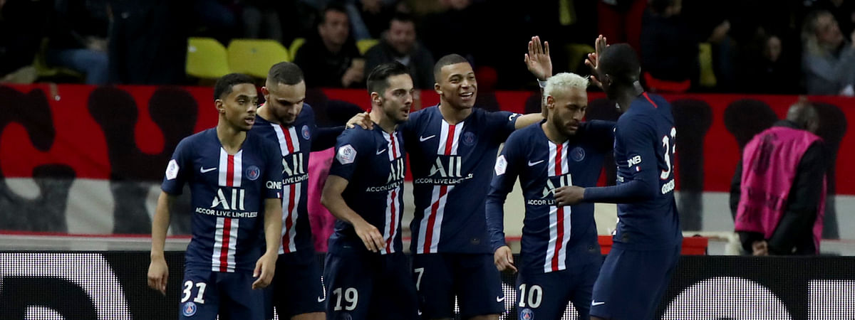 PSG's Kylian Mbappe, center, celebrates with teammates after scoring his side's fourth goal during the French League One soccer match between Monaco and Paris Saint-Germain at the Louis II stadium in Monaco, Wednesday, Jan. 15, 2019.