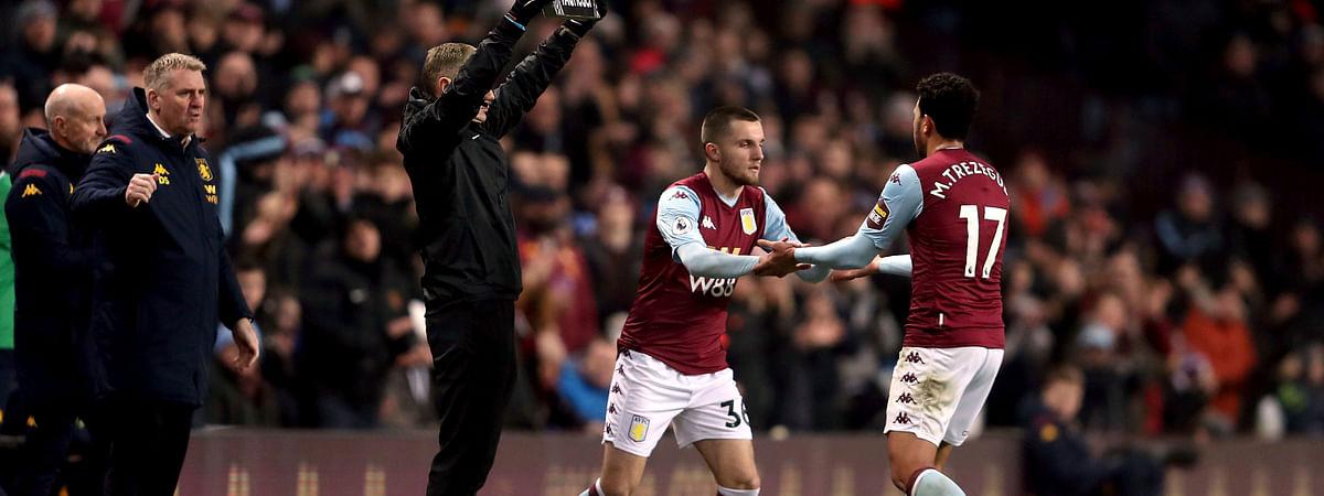 Aston Villa's Indiana Vassilev, center, replaces Aston Villa's Trezeguet during the English Premier League match against Watford at Villa Park, Birmingham, England, Tuesday Jan. 21, 2020.