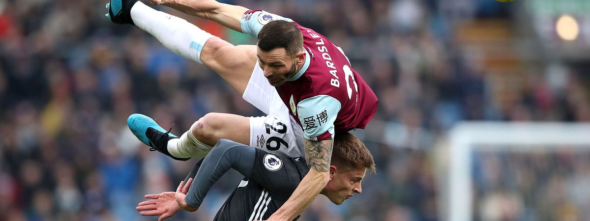 Leicester City's Harvey Barnes vies for the ball with Burnley's Phil Bardsley, in air, during the English Premier League soccer match between Burnley and Leicester City at Turf Moor, in Burnley, England, Sunday, Jan. 19, 2020.