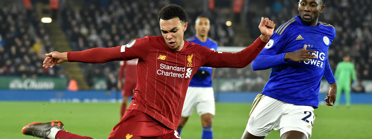 Liverpool's Trent Alexander-Arnold, left, kicks the ball ahead of Leicester's Wilfred Ndidi during the English Premier League soccer match between Leicester City and Liverpool at the King Power Stadium in Leicester, England, Thursday, Dec. 26, 2019.