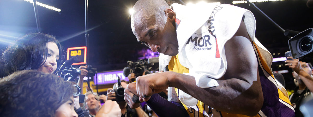 In this April 13, 2016 file photo Los Angeles Lakers' Kobe Bryant, right, fist-bumps his daughter Gianna after the last NBA basketball game of his career, against the Utah Jazz in Los Angeles. Bryant, the 18-time NBA All-Star who won five championships and became one of the greatest basketball players of his generation during a 20-year career with the Los Angeles Lakers, died in a helicopter crash Sunday, Jan. 26, 2020. Gianna also died in the crash.