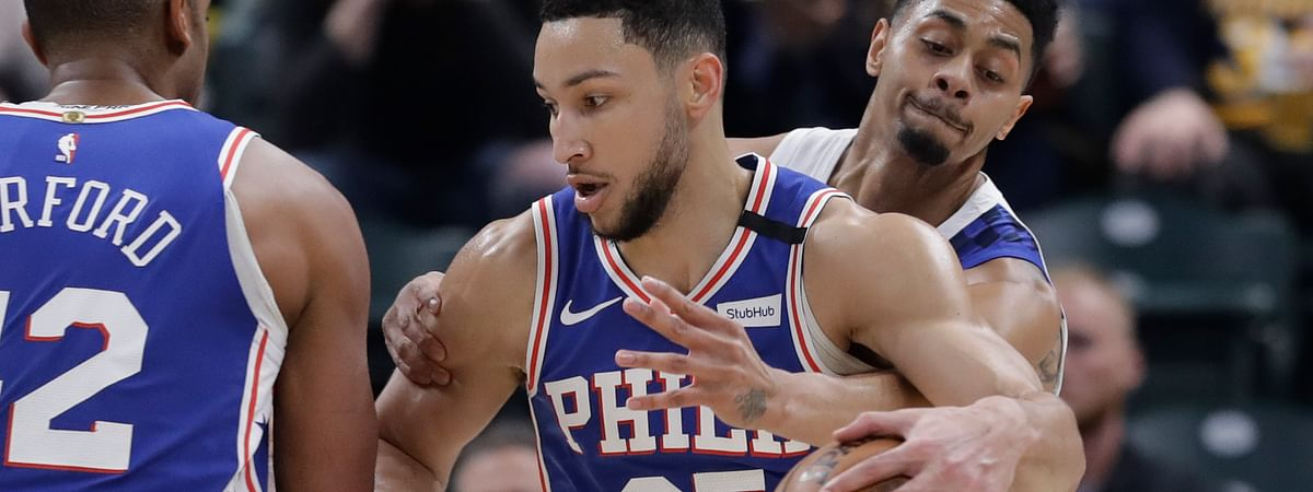 Philadelphia 76ers' Ben Simmons (25) is defended by Indiana Pacers' Jeremy Lamb (26) during the first half of an NBA basketball game, Monday, Jan. 13, 2020, in Indianapolis.