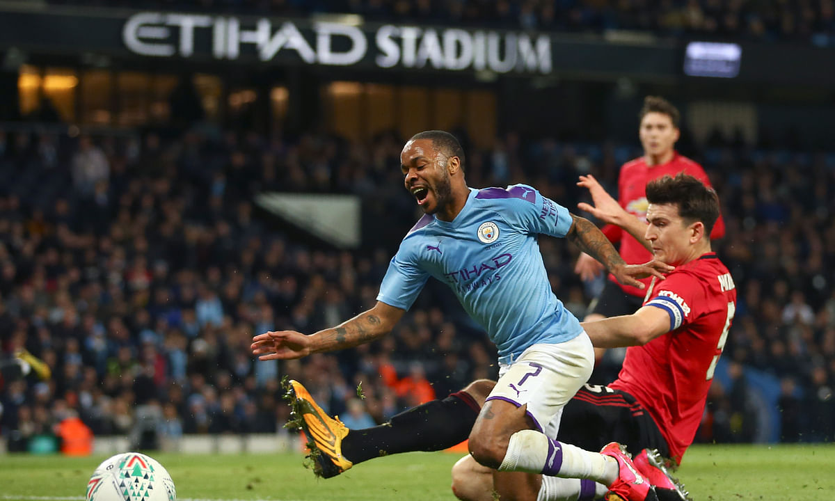Manchester United's Harry Maguire tackles Manchester City's Raheem Sterling, left, during the English League Cup semifinal second leg soccer match between Manchester City and Manchester United at Etihad stadium in Manchester, England, Wednesday, Jan. 29, 2020.
