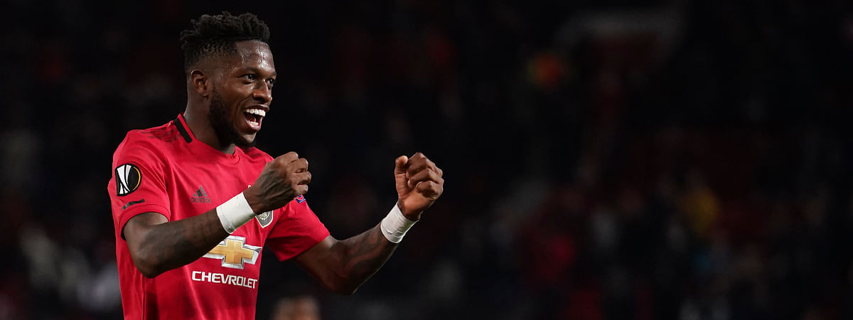 Manchester United's Fred celebrates after scoring his side's fifth goal during the round of 32 second leg Europa League soccer match between Manchester United and Brugge at Old Trafford in Manchester, England, Thursday, Feb. 27, 2020.