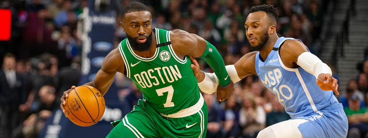 Boston Celtics guard Jaylen Brown (7) drives against Minnesota Timberwolves guard Josh Okogie (20) in the second quarter of an NBA basketball game Friday, Feb. 21, 2020, in Minneapolis. (AP Photo/Andy Clayton-King)