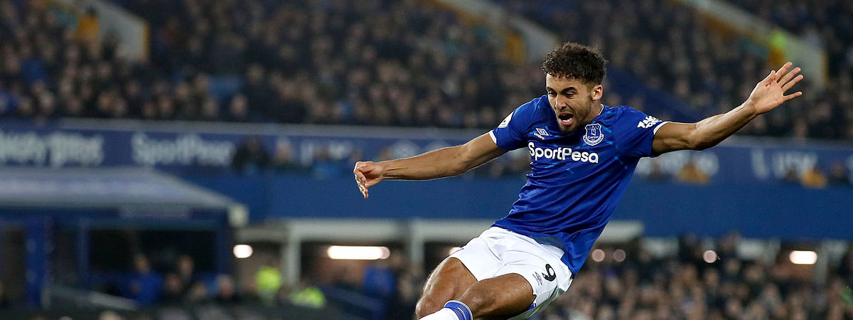 Everton's Dominic Calvert-Lewin scores his side's second goal of the game against Newcastle United during their English Premier League soccer match at Goodison Park in Liverpool, England, Tuesday Jan. 21, 2020.