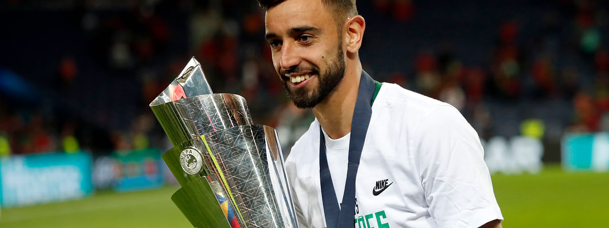 FILE - In this June 9, 2019, file photo, Portugal's Bruno Fernandes poses with the trophy at the end of the UEFA Nations League final soccer match between Portugal and Netherlands at the Dragao stadium in Porto, Portugal. According to news reports Wednesday, Jan. 29, 2020, Lisbon's Sporting CP midfielder Fernandes is expected to join Manchester United following months of negotiations between the two clubs. (AP Photo/Armando Franca, FILE)