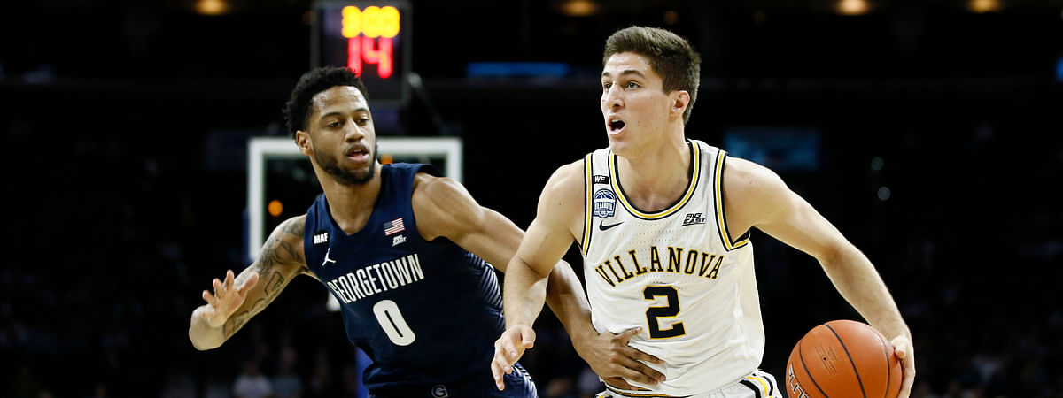 Villanova's Collin Gillespie, right, tries to dribble past Georgetown's Jahvon Blair, Saturday, Jan. 11, 2020, in Philadelphia. (AP Photo/Matt Slocum)