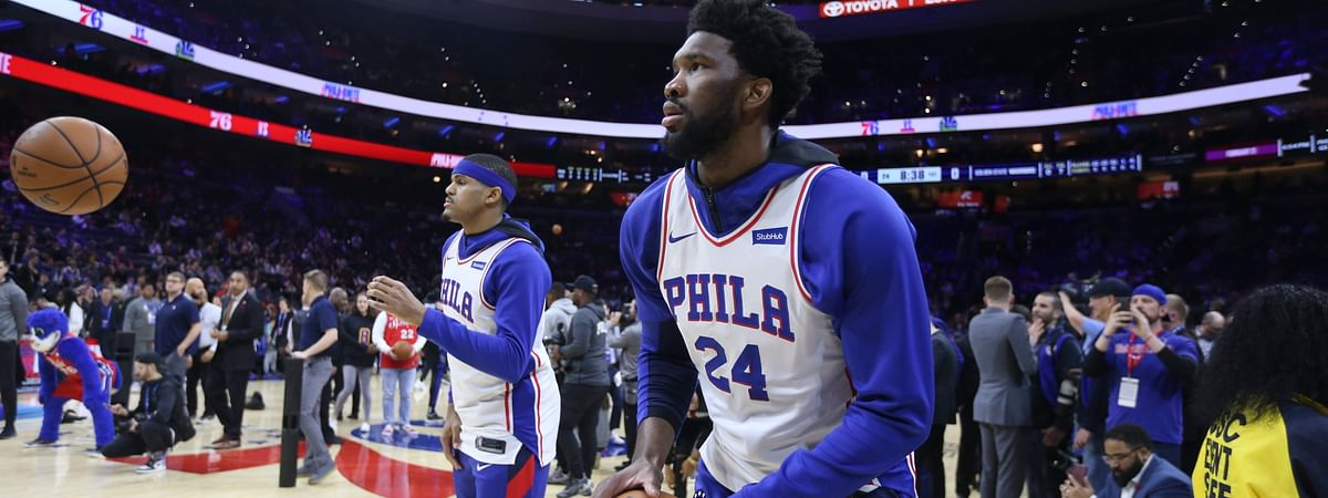 Philadelphia 76ers' Joel Embiid, front, and teammates wear jerseys with Kobe Bryant's number on them before the team's NBA basketball game against the Golden State Warriors on Tuesday, Jan. 28, 2020, in Philadelphia.