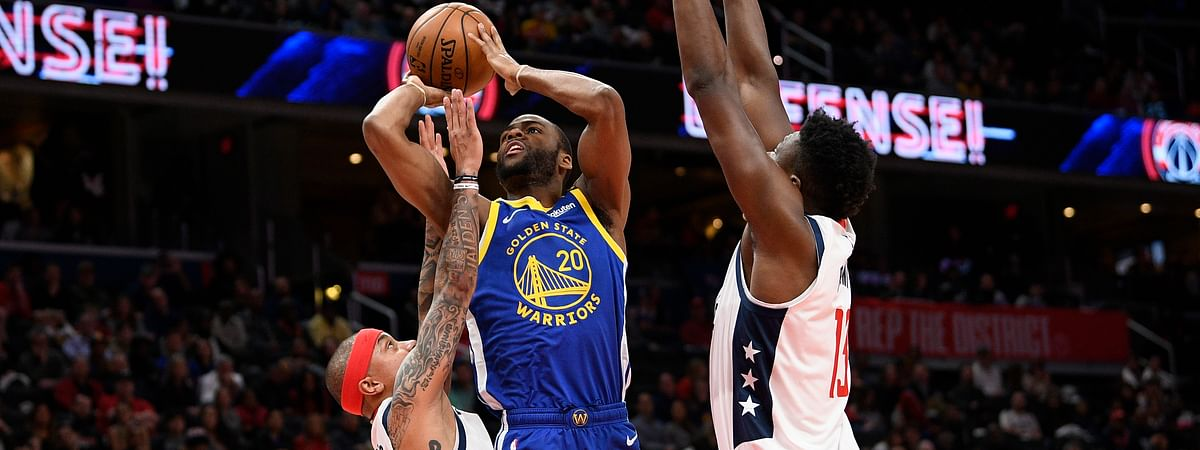 Golden State Warriors guard Alec Burks (20) goes to the basket between Washington Wizards guard Isaiah Thomas (4) and center Thomas Bryant, right, during the first half of an NBA basketball game, Monday, Feb. 3, 2020, in Washington.