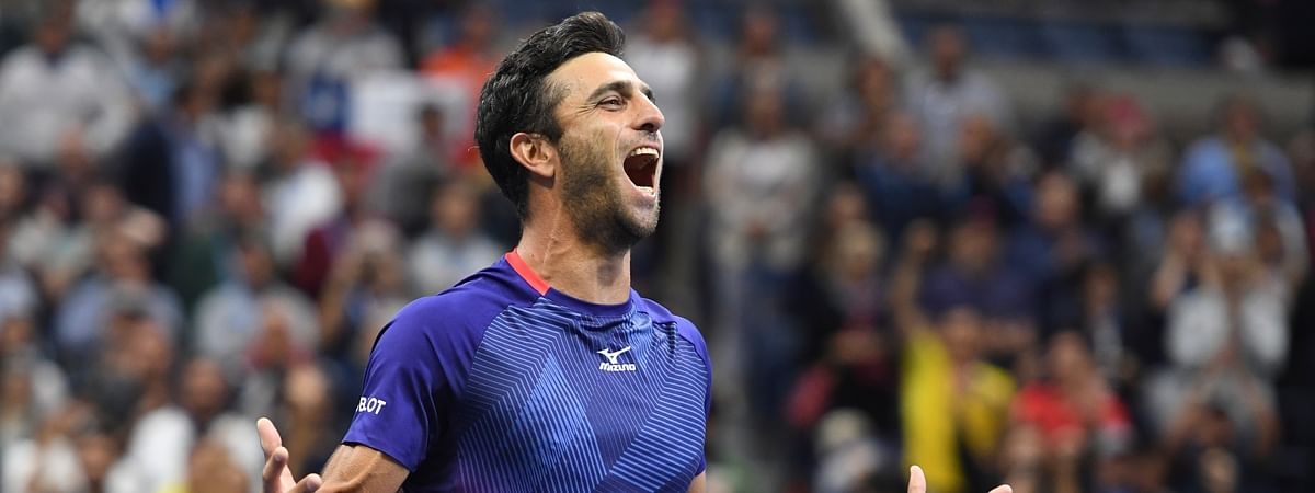 In this September, 2019 file photo, Colombia's Robert Farah reacts after winning the men's doubles final with partner Juan Sebastian Cabal against Marcel Granollers, of Spain, and Horacio Zeballos, of Argentina, during the final match of the U.S. Open tennis championships, in New York.