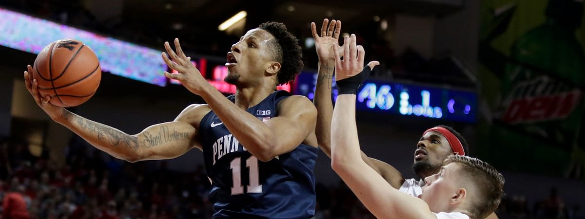 Penn State's Lamar Stevens (11) goes to the basket past Nebraska's Thorir Thorbjarnarson (34) and Dachon Burke Jr., right rear, during the second half of an NCAA college basketball game in Lincoln, Neb., Saturday, Feb. 1, 2020.