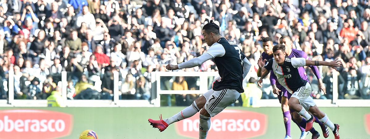 Juventus' Cristiano Ronaldo scores his side's second goal during the Serie A soccer match between Juventus and Fiorentina, at the Allianz Stadium in Turin, Italy, Sunday, Feb. 2, 2020. (Fabio Ferrari/Lapresse via AP)