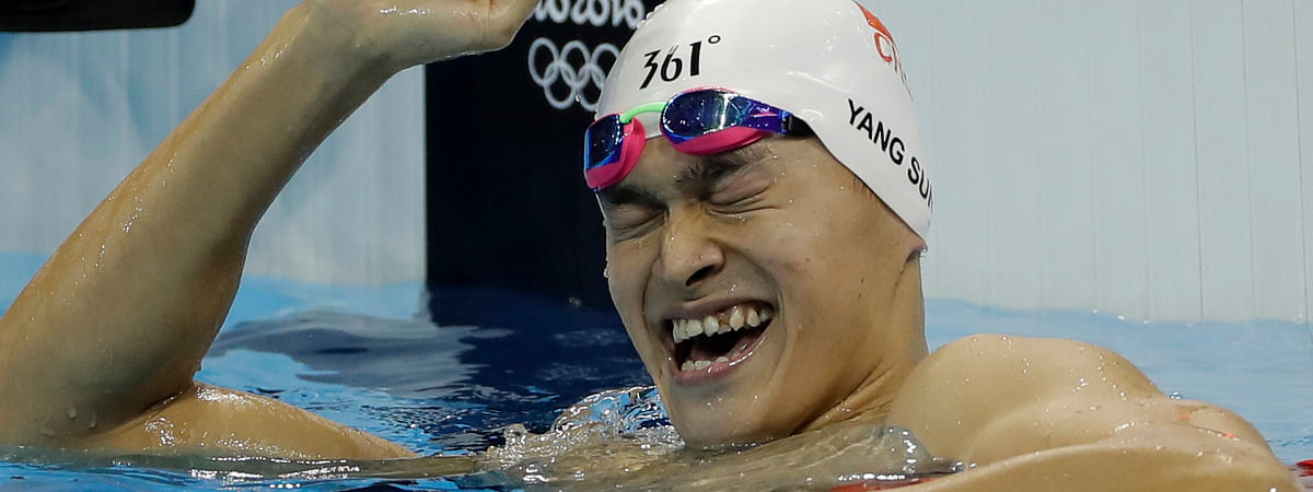 FILE - In this Monday, Aug. 8, 2016 file photo China's Sun Yang celebrates winning the final of the men's 200-meter freestyle during the swimming competitions at the 2016 Summer Olympics in Rio de Janeiro, Brazil. Chinese swimmer Sun Yang has been banned for eight years for breaking anti-doping rules and will miss the 2020 Tokyo Olympics. (AP Photo/Matt Slocum, File)