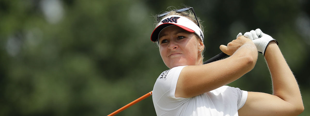 FILE - In this Friday, May 31, 2019 file photo, Anna Nordqvist of Sweden, watches her ball on the 13th tee during the second round of the U.S. Women's Open golf tournament in Charleston, S.C. The major golf tours may have shut down during the coronavirus outbreak, but a handful of mini tours are playing through. (AP Photo/Steve Helber, File)